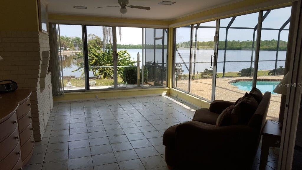What a sunroom!  Yes, that is a fireplace in the room. - Single Family Home for sale at 450 Coral Creek Dr, Placida, FL 33946 - MLS Number is D5901346