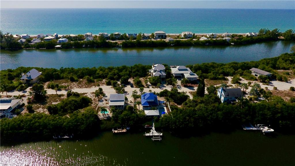 Aerial Showing Home on Kettle Harbor, Bocilla Lagoon and then the Gulf of Mexico...Not Far Away. - Single Family Home for sale at 120 Bocilla Dr, Placida, FL 33946 - MLS Number is D5907510