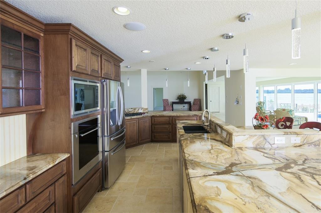 Open Kitchen - Single Family Home for sale at 7295 Manasota Key Rd, Englewood, FL 34223 - MLS Number is D5911936