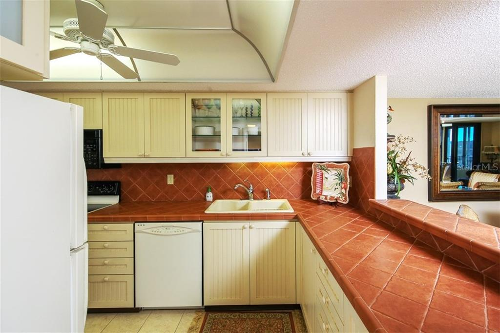 Open Kitchen - Condo for sale at 5760 Midnight Pass Rd #702, Sarasota, FL 34242 - MLS Number is D5916943