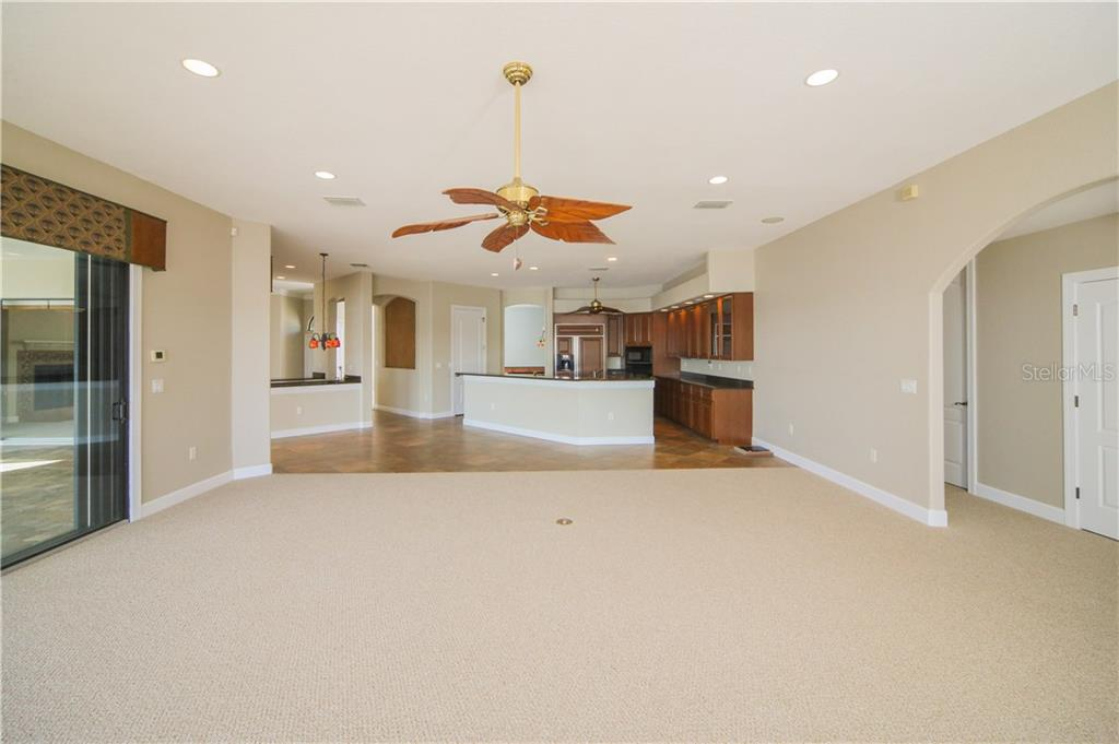 Large Family Room off Kitchen with Sliders to Lanai/Pool - Single Family Home for sale at 550 Coral Creek Dr, Placida, FL 33946 - MLS Number is D5917129