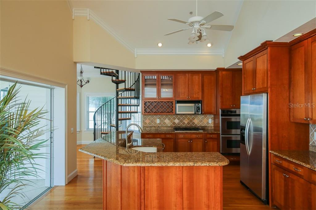 Open Kitchen - Single Family Home for sale at 7020 Palm Island Dr, Placida, FL 33946 - MLS Number is D5917629