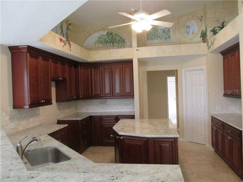 The kitchen is newly remodeled and never cooked in.  Granite counters, solid wood cabinets, large island under cabinet and over cabinet lighting, breakfast bar and walk in pantry.  Ready for your next party - Single Family Home for sale at 3001 Rivershore Ln, Port Charlotte, FL 33953 - MLS Number is D5917929