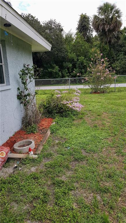 Backyard Roses and Orchids - Single Family Home for sale at 1570 Scotten St, Port Charlotte, FL 33952 - MLS Number is D5918705
