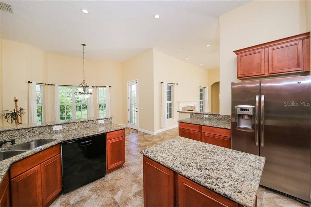 Open Kitchen Area With Island   Single Family Home For Sale At 10389 Atenia  St,