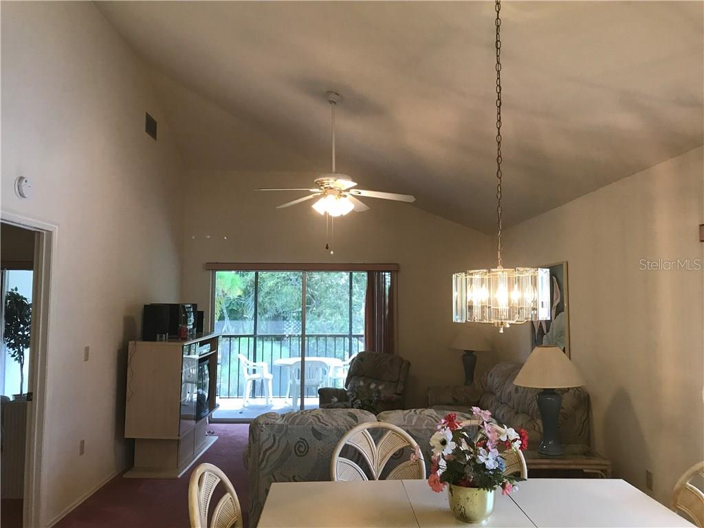 End unit with vaulted ceiling provides lots of light - Condo for sale at 6800 Placida Rd #253, Englewood, FL 34224 - MLS Number is D5919792