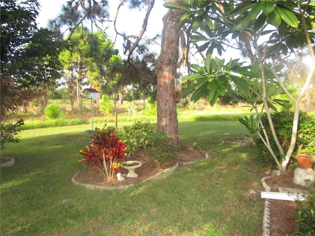 Beautiful landscaped backyard looking into nature preserve. - Condo for sale at 6796 Gasparilla Pines Blvd #14, Englewood, FL 34224 - MLS Number is D5919892