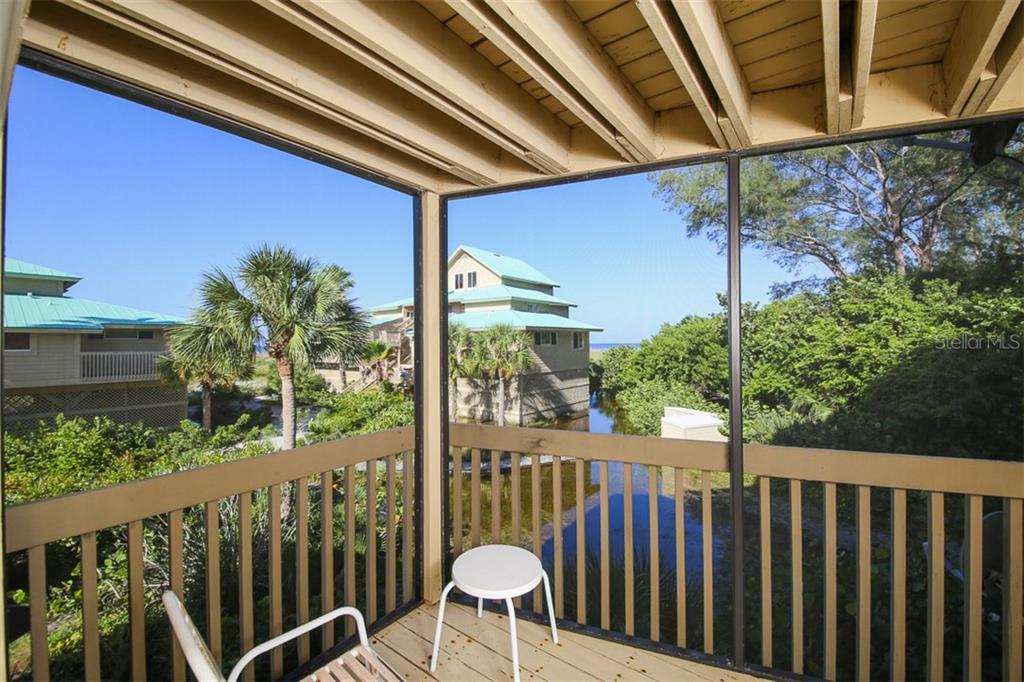 Screened porch off Master Bedroom & Living Room - Condo for sale at 9200 Little Gasparilla Is #203, Placida, FL 33946 - MLS Number is D5920072