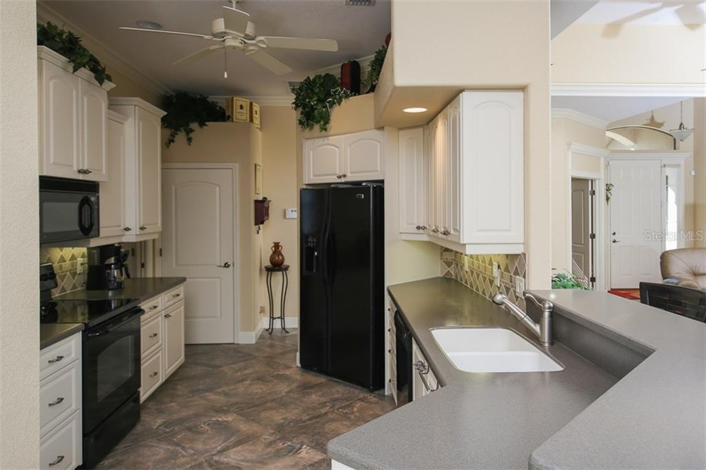 KITCHEN - Single Family Home for sale at 2634 Royal Palm Dr, North Port, FL 34288 - MLS Number is D5920557