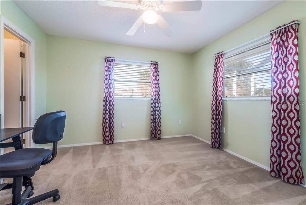 2nd bedroom with walk in closet. - Single Family Home for sale at 11010 Deerwood Ave, Englewood, FL 34224 - MLS Number is D5921766