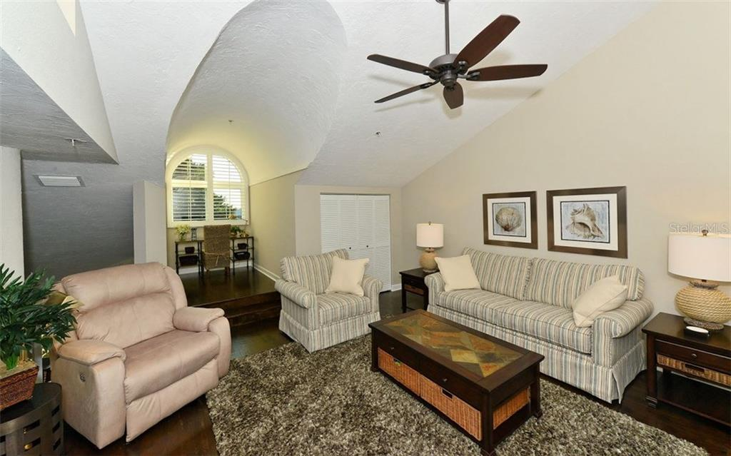 Third Bedroom is beside den and bath, and features lovely pine views and under-eave storage. - Condo for sale at 11000 Placida Rd #1303, Placida, FL 33946 - MLS Number is D5921767