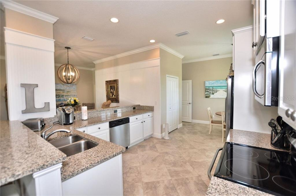 Kitchen - Single Family Home for sale at 8944 Scallop Way, Placida, FL 33946 - MLS Number is D5923173