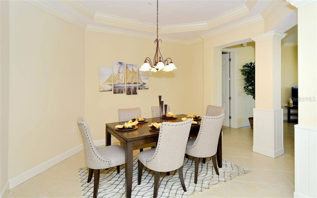 Formal Dining Room - Condo for sale at 8561 Amberjack Cir #402, Englewood, FL 34224 - MLS Number is D5923600