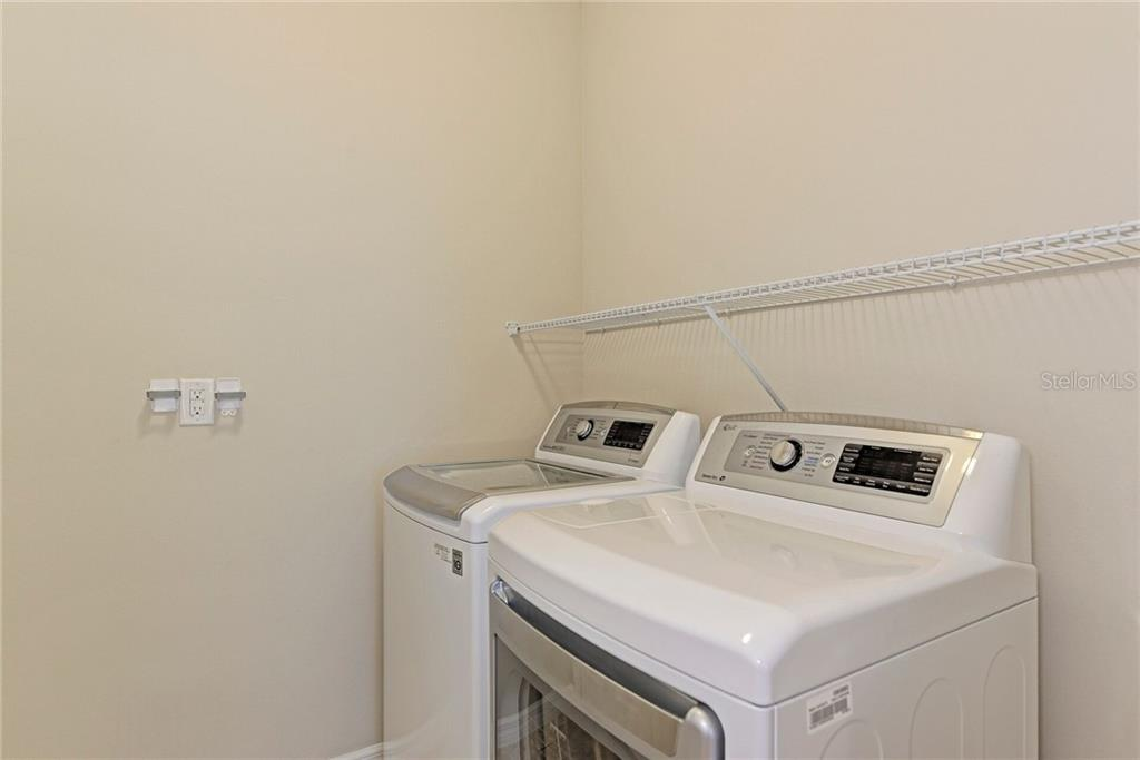 Inside laundry/utility room with gas dryer. - Single Family Home for sale at 141 Avens Dr, Nokomis, FL 34275 - MLS Number is D6100104