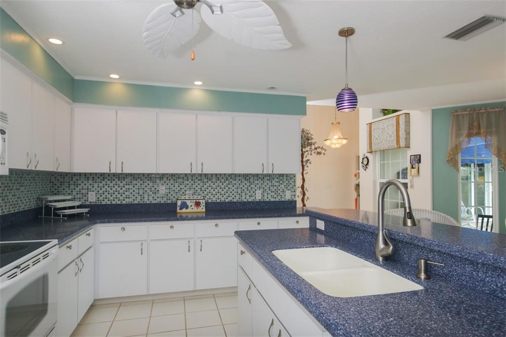 Open Kitchen - Single Family Home for sale at 222 Westwind Dr, Placida, FL 33946 - MLS Number is D6100545