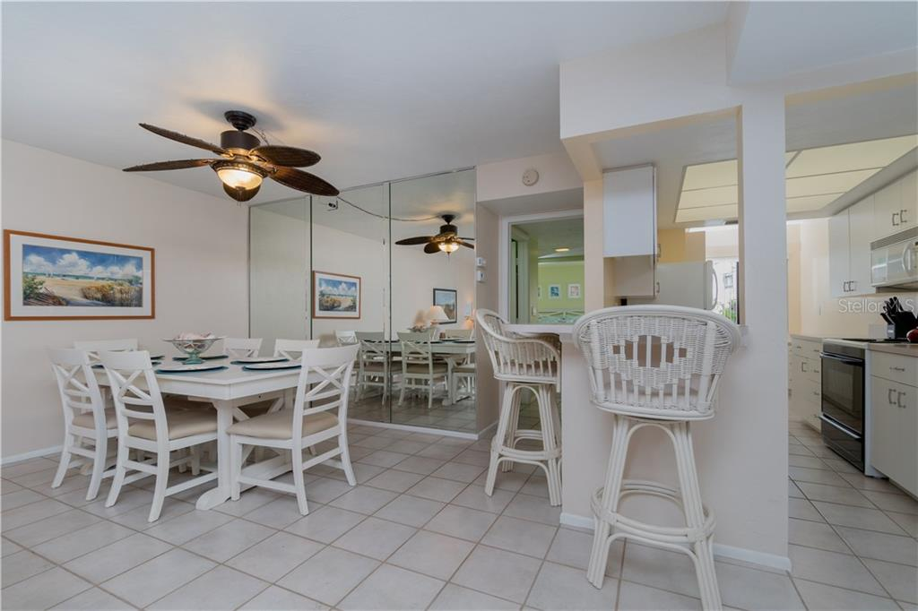 Dining Room and Kitchen - Condo for sale at 2955 N Beach Rd #b612, Englewood, FL 34223 - MLS Number is D6101147