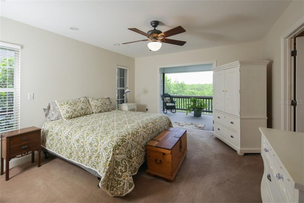 Master bedroom with french doors to screened back porch. - Single Family Home for sale at 43 Bayshore Cir, Placida, FL 33946 - MLS Number is D6101722