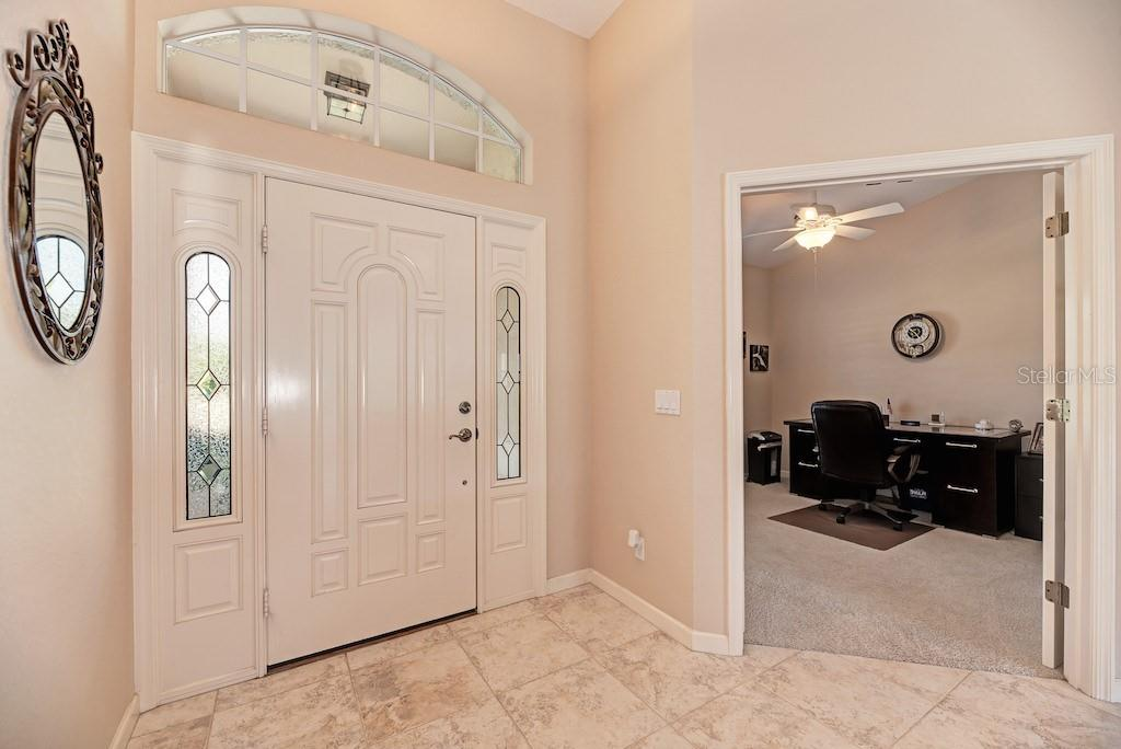 Entrance to home with a view of the den/office which could also be utilized for additional guests. - Single Family Home for sale at 7256 Holsum St, Englewood, FL 34224 - MLS Number is D6101787