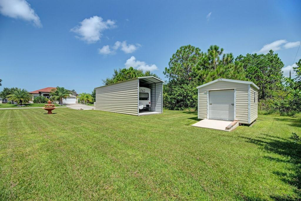 Drive through RV/boat storage and separate shed for your lawn tools. - Single Family Home for sale at 7256 Holsum St, Englewood, FL 34224 - MLS Number is D6101787