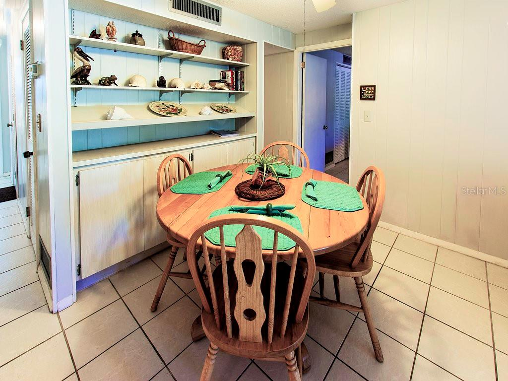 Dining space is part of the living/dining!  More cabinets mean more storage space! - Condo for sale at 2980 N Beach Rd #c2-4, Englewood, FL 34223 - MLS Number is D6101944