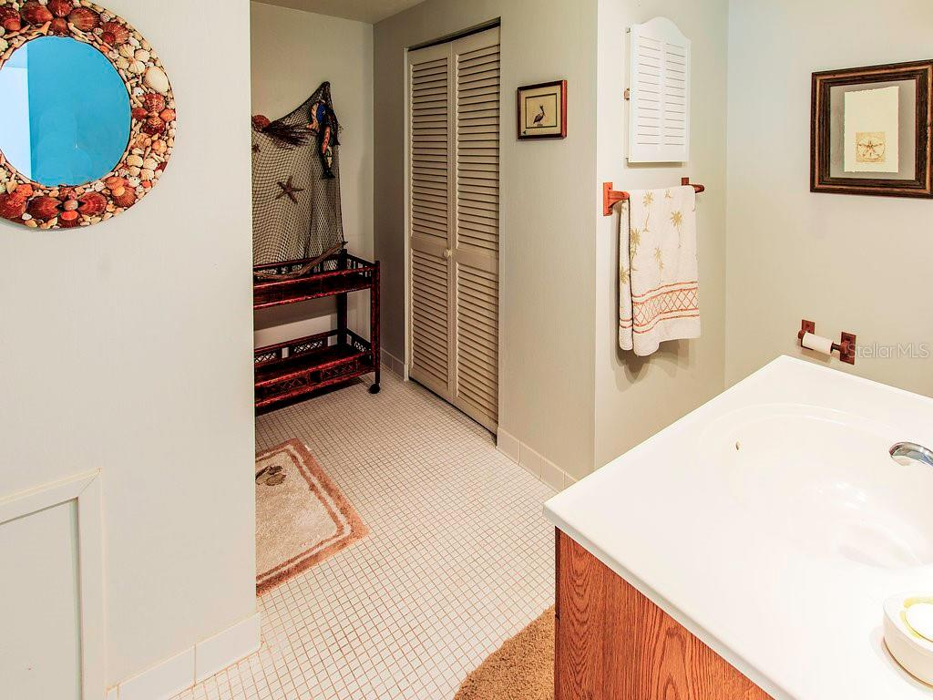 en suite bathroom with a tub/shower combo and huge storage closet! - Condo for sale at 2980 N Beach Rd #c2-4, Englewood, FL 34223 - MLS Number is D6101944