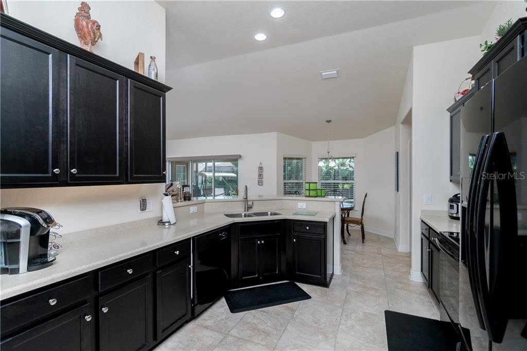 Plenty of cabinet space in this well appointed corian counter topped kitchen. - Single Family Home for sale at 71 Mariner Ln, Rotonda West, FL 33947 - MLS Number is D6101950