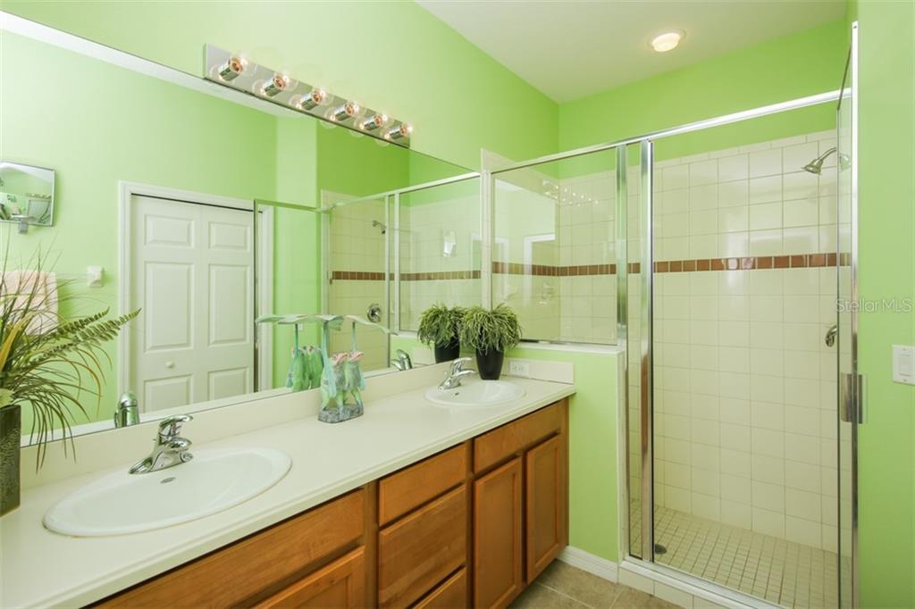 Wood cabinets, large shower and an immaculate HUGE walk-in closet highlight this master bathroom. - Villa for sale at 29704 Niagara Ct, Englewood, FL 34223 - MLS Number is D6102386