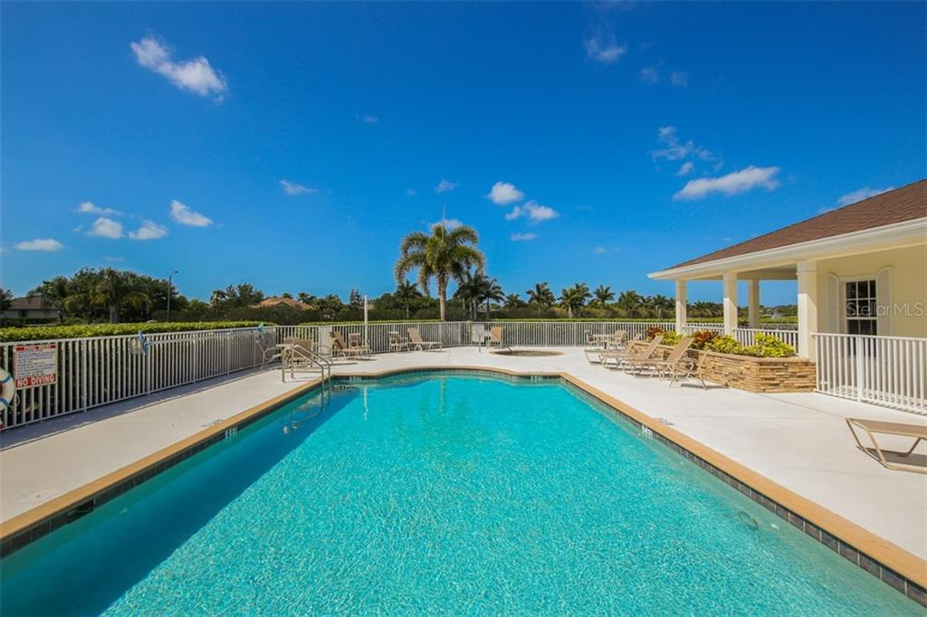 What a beautiful place to call home and enjoy our beautiful Florida weather! The heated spa is in the background. - Villa for sale at 29704 Niagara Ct, Englewood, FL 34223 - MLS Number is D6102386