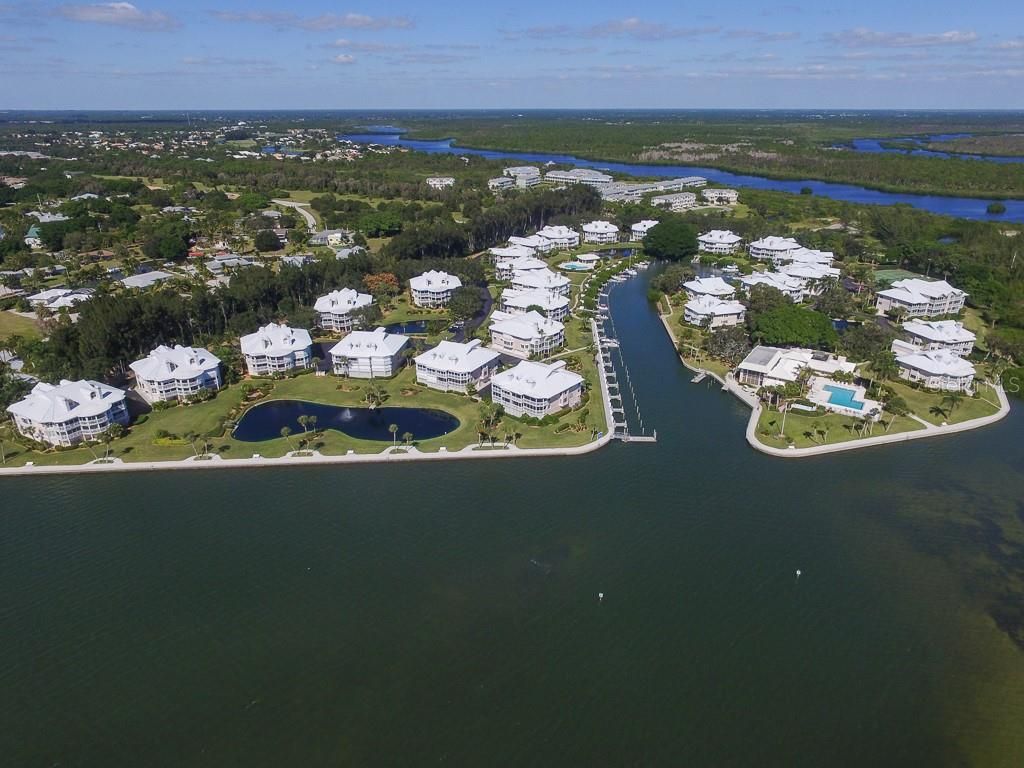 Aerial view of Placida Harbour Club from Intracoastal - Condo for sale at 11000 Placida Rd #2103, Placida, FL 33946 - MLS Number is D6102674