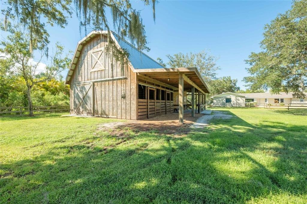 This traditionally styled barn is the ultimate multi purpose building.  It is built to the same stringent hurricane code any home of the same period is - Single Family Home for sale at 7339 Hawkins Rd, Sarasota, FL 34241 - MLS Number is D6102762