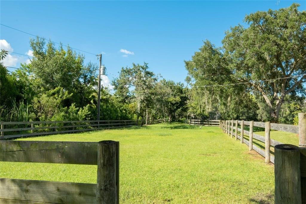 The pastures can be separated into 3 distinct areas for purposes of horse management and pasture rotation - Single Family Home for sale at 7339 Hawkins Rd, Sarasota, FL 34241 - MLS Number is D6102762
