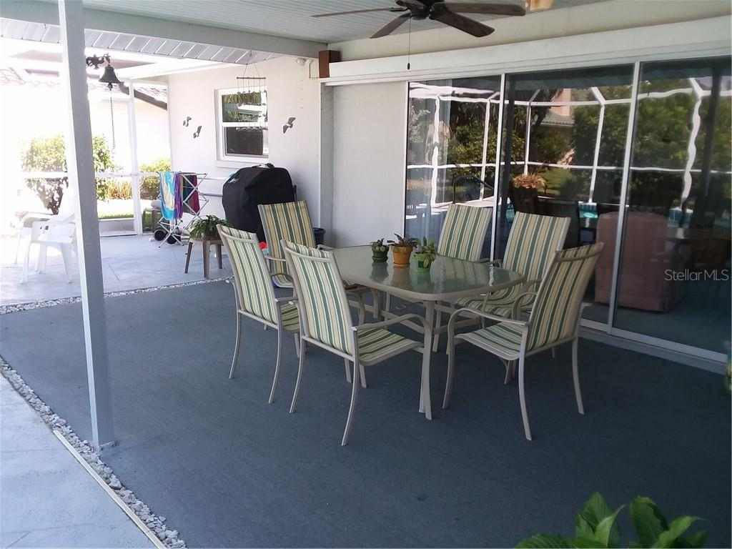 Another Dining Area, this one on Pool Deck - Single Family Home for sale at 7 Old Trail Rd, Englewood, FL 34223 - MLS Number is D6102912