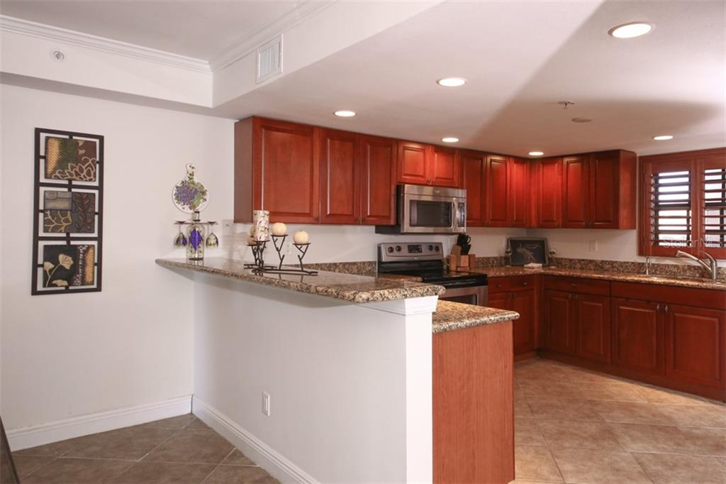 Breakfast Bar with Granite Counter Tops - Condo for sale at 50 Meredith Dr #8, Englewood, FL 34223 - MLS Number is D6103644