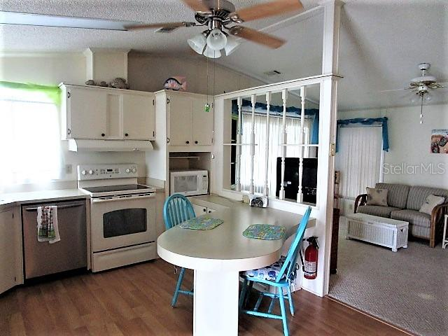 Kitchen is open to all main living areas. - Manufactured Home for sale at 1800 Englewood Rd #95, Englewood, FL 34223 - MLS Number is D6103776