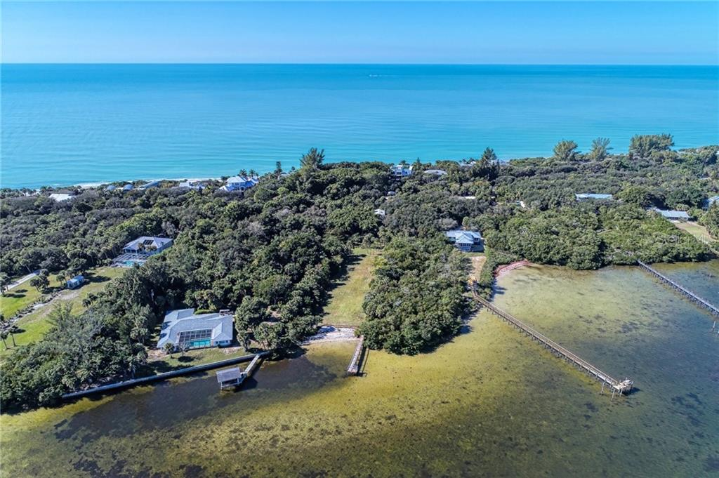 There is deeded access to the bay from the property with a sea wall. - Single Family Home for sale at 7400 Manasota Key Rd, Englewood, FL 34223 - MLS Number is D6104362