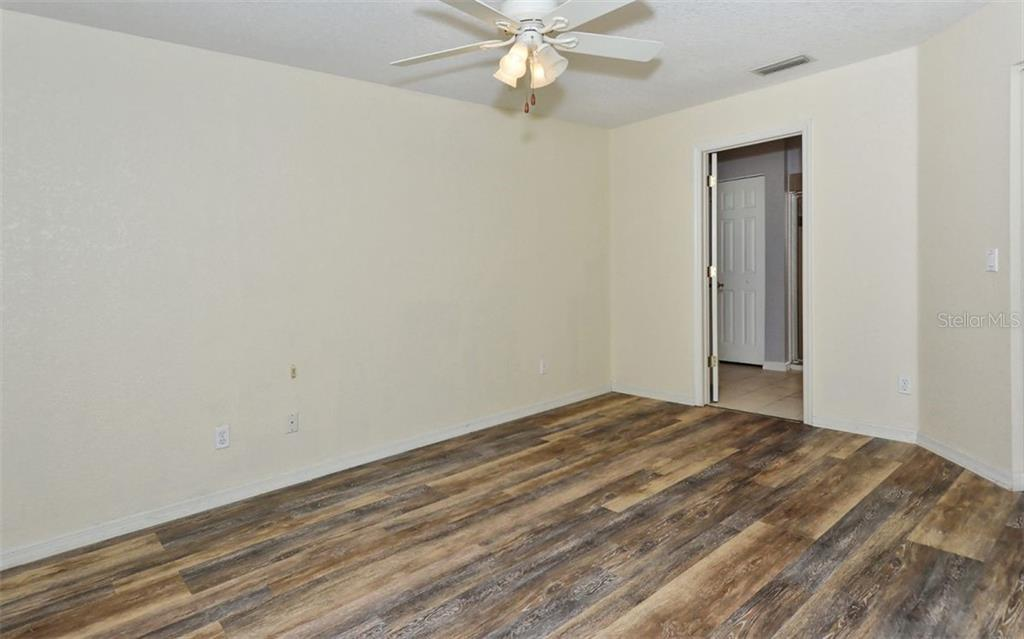 Master Bedroom with new laminate flooring - Single Family Home for sale at 5376 Ashwood Rd, Port Charlotte, FL 33981 - MLS Number is D6105888