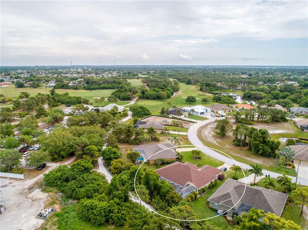 An aerial view of the rear of the property and surrounding area. - Single Family Home for sale at 30 Medalist Way, Rotonda West, FL 33947 - MLS Number is D6106239
