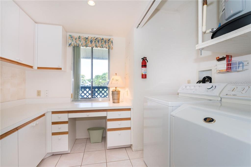 Laundry and work space off of kitchen - Lots of storage! - Condo for sale at 6800 Placida Rd #271, Englewood, FL 34224 - MLS Number is D6106459