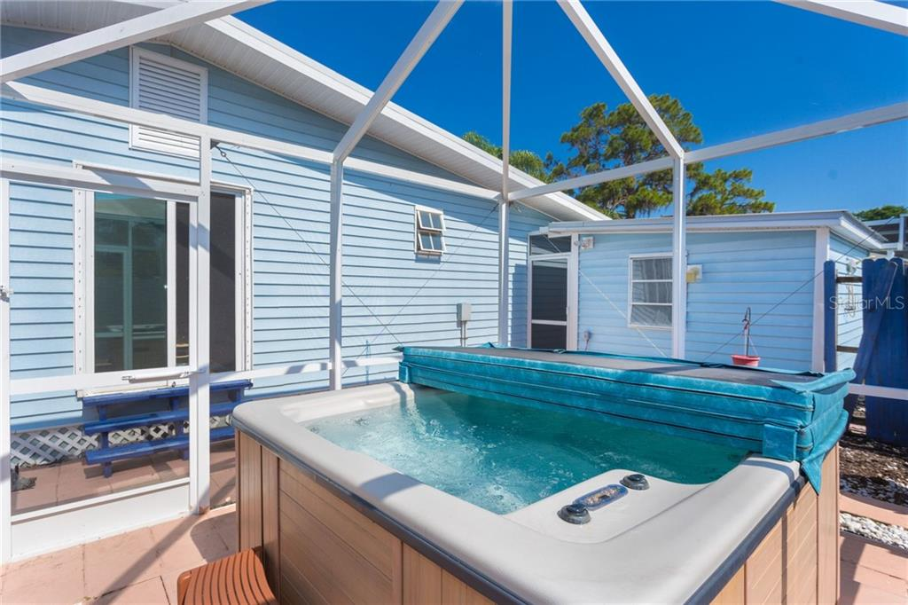 enjoy your private hot tub just steps from the main house - Single Family Home for sale at 190 W Wentworth St, Englewood, FL 34223 - MLS Number is D6106918