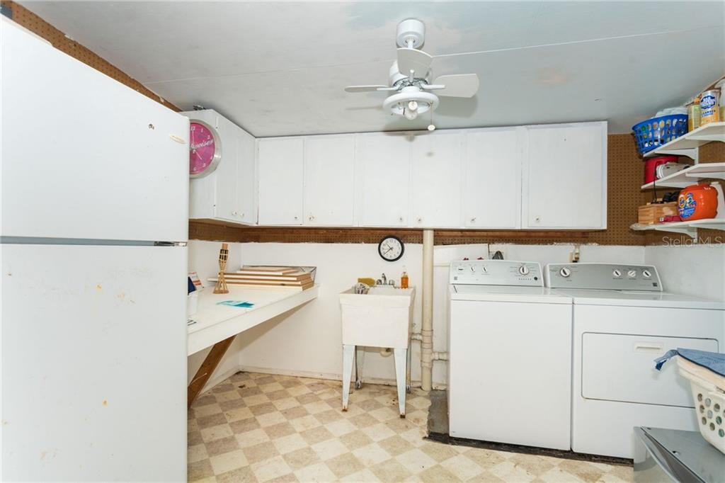 Large laundry and storage room, with easy access from the in-law suite or the main house - Single Family Home for sale at 190 W Wentworth St, Englewood, FL 34223 - MLS Number is D6106918