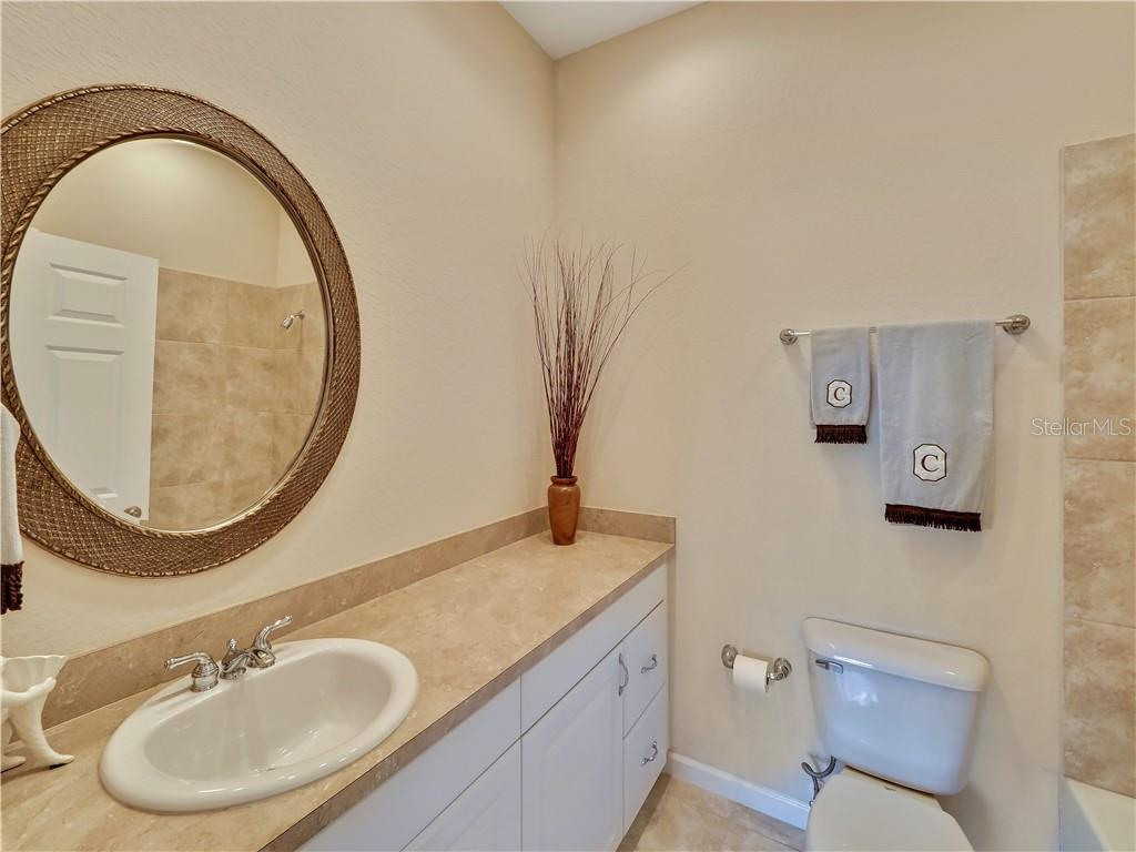 One of the guest bathrooms - Single Family Home for sale at 13283 Eisenhower Dr, Port Charlotte, FL 33953 - MLS Number is D6107998