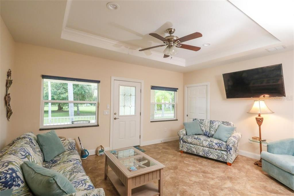 Guest House living room - Single Family Home for sale at 140 S Oxford Dr, Englewood, FL 34223 - MLS Number is D6108024