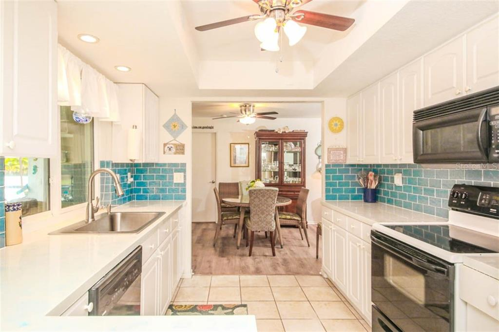 updated kitchen - Single Family Home for sale at 913 Tropical Ave Nw, Port Charlotte, FL 33948 - MLS Number is D6108061