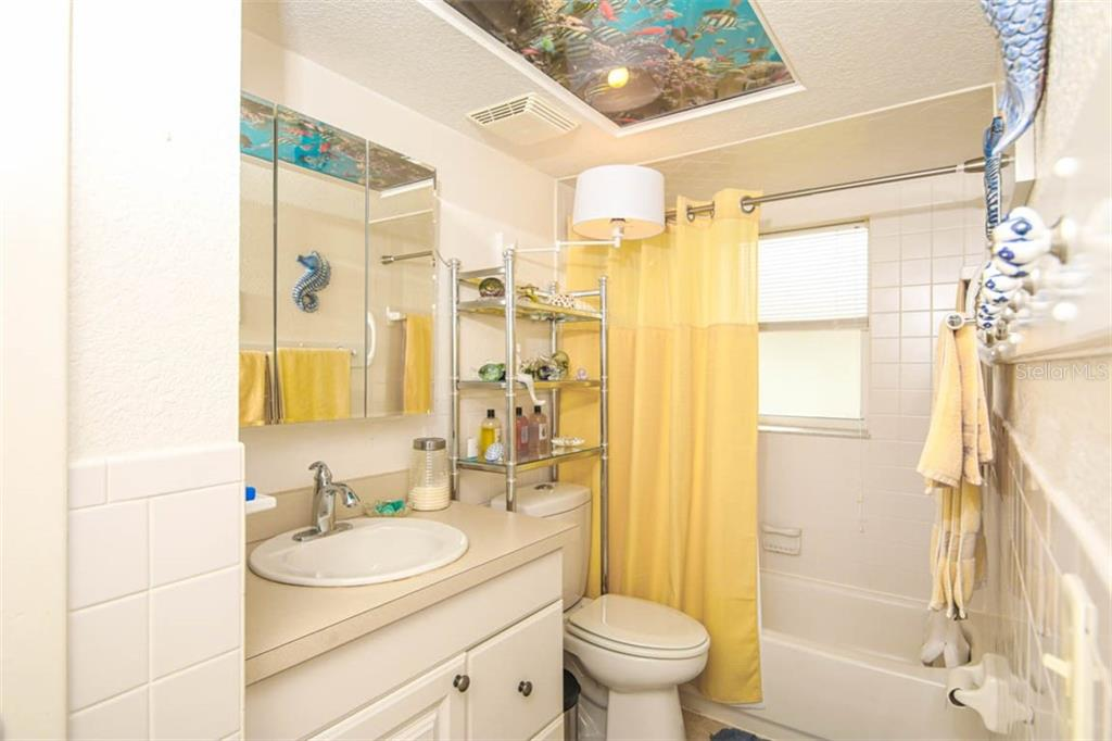 updated guest bathroom - Single Family Home for sale at 913 Tropical Ave Nw, Port Charlotte, FL 33948 - MLS Number is D6108061