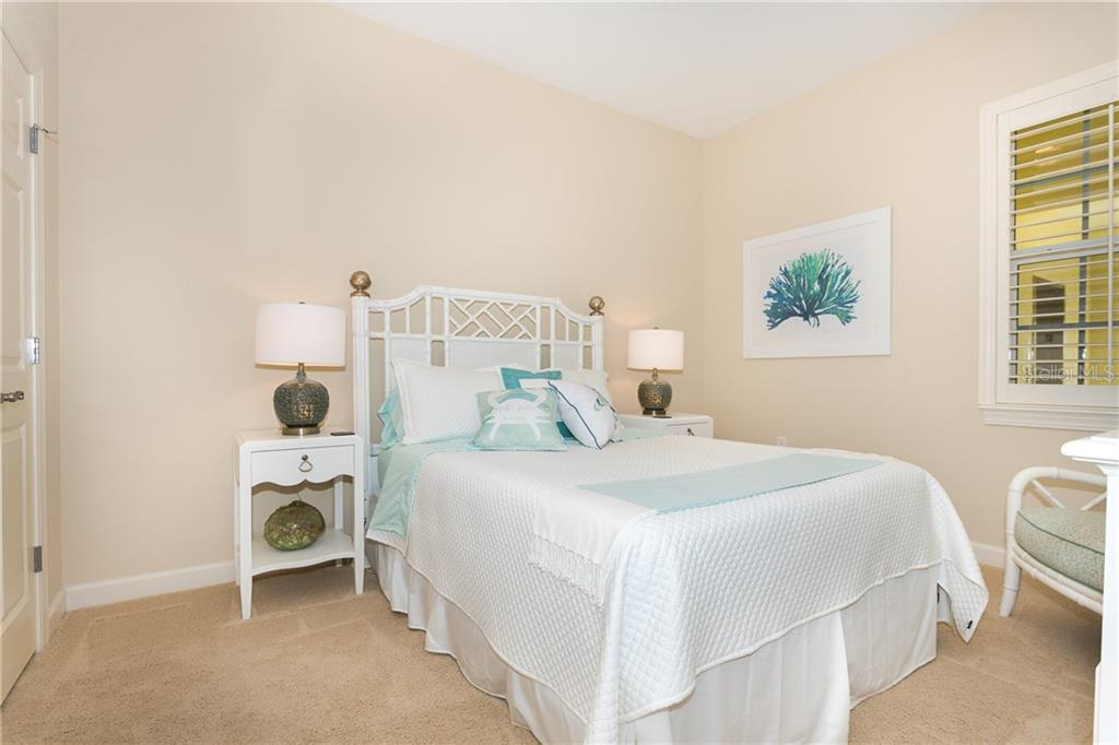 2nd Spacious Bedroom with large closet - Condo for sale at 8561 Amberjack Cir #202, Englewood, FL 34224 - MLS Number is D6109771