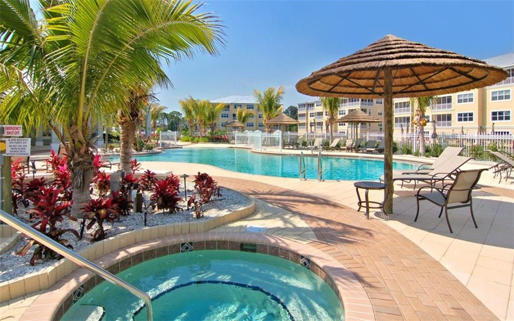 Spa & Amazing Pool for your relaxation or entertainment - Condo for sale at 8561 Amberjack Cir #202, Englewood, FL 34224 - MLS Number is D6109771