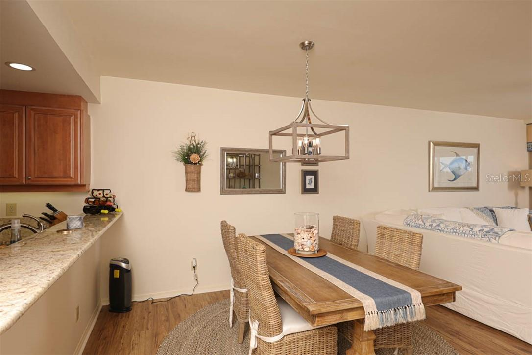 Dining Room - Condo for sale at 11000 Placida Rd #306, Placida, FL 33946 - MLS Number is D6110298