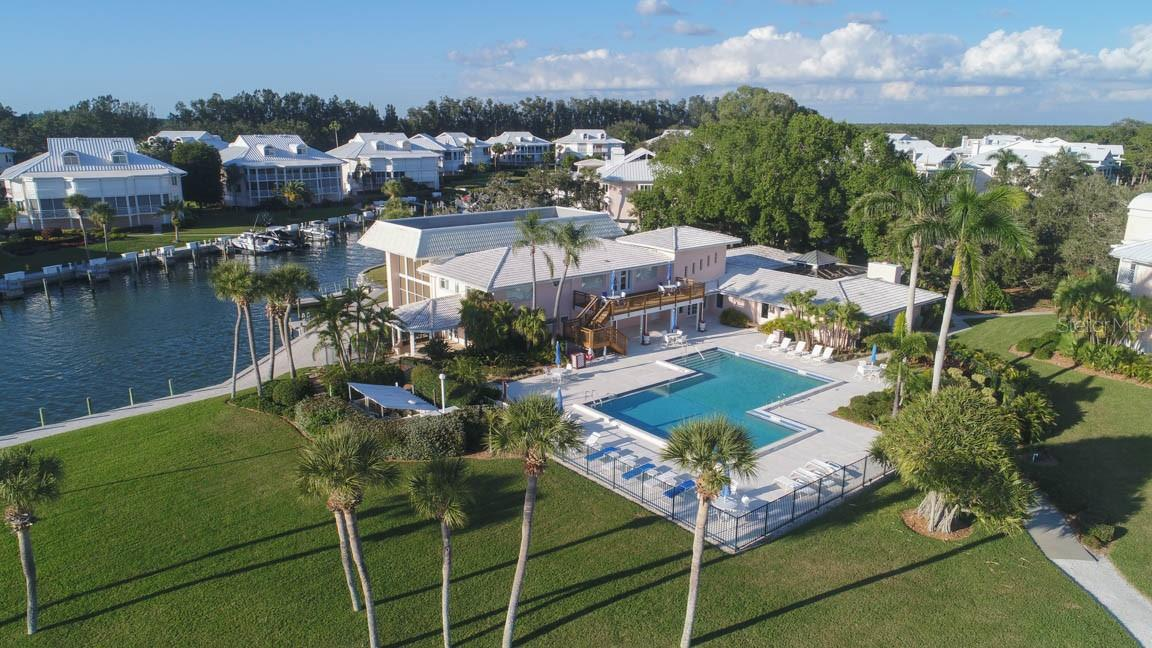Main Clubhouse & Pool offers saunas, fitness, card rooms, kitchen & several gathering areas - Condo for sale at 11000 Placida Rd #306, Placida, FL 33946 - MLS Number is D6110298