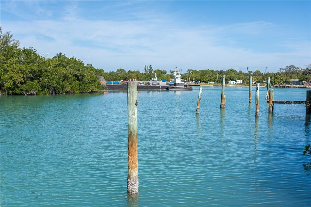 View of Intracoastal and Car Passenger Ferry from Dock. - Single Family Home for sale at 5 Pointe Way, Placida, FL 33946 - MLS Number is D6110468