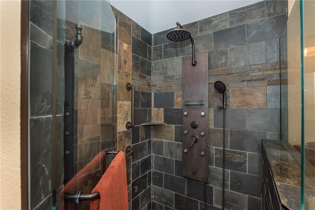 Master Bath floor to ceiling slate shower - Single Family Home for sale at 1199 Seahorse Ln, Englewood, FL 34224 - MLS Number is D6110877